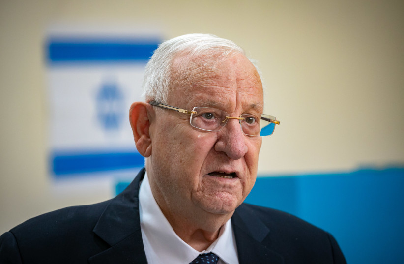President Reuven Rivlin casts his ballot at a voting station in Jerusalem, during the Knesset Elections, on March 23, 2021.  (photo credit: OLIVIER FITOUSSI/FLASH90)