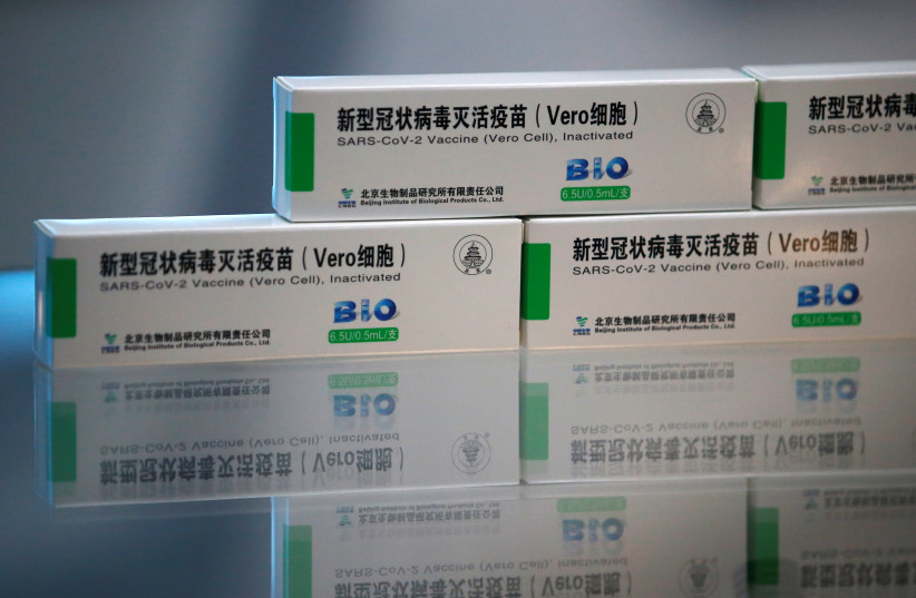 Packages of COVID-19 vaccines by Beijing Institute of Biological Products of Sinopharm's China National Biotec Group (CNBG), are displayed during a government-organised visit to the vaccine's production line in Beijing, China February 26, 2021.  (photo credit: REUTERS/TINGSHU WANG)