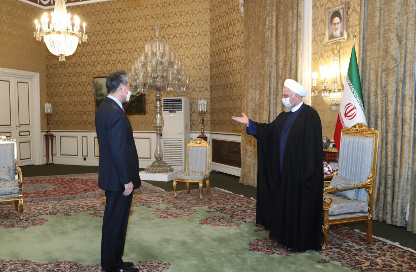 Iranian President Hassan Rouhani meets with Chinese Foreign Minister Wang Yi, in Tehran, Iran March 27, 2021. (photo credit: REUTERS)