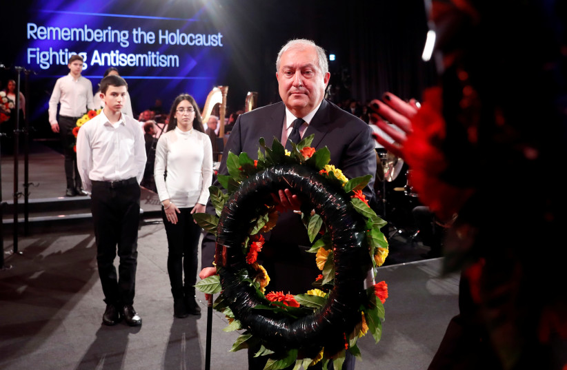 ARMENIAN PRESIDENT Armen Sarkissian takes part in a wreath-laying ceremony at Yad Vashem – The World Holocaust Remembrance Center, in Jerusalem last year. (photo credit: RONEN ZVULUN/REUTERS)