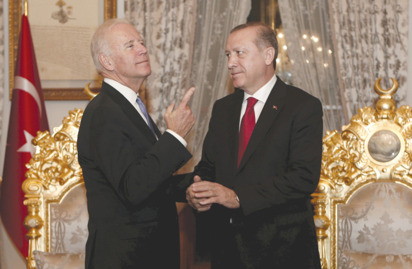 TURKISH PRESIDENT Recep Tayyip Erdogan and then-US vice president Joe Biden chat after their meeting in Istanbul in 2016.  (photo credit: REUTERS)