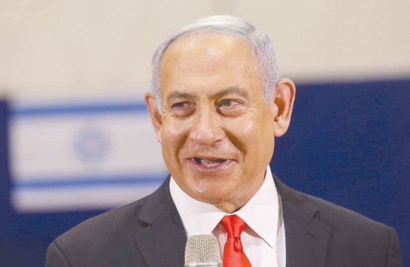 PRIME MINISTER Benjamin Netanyahu speaks after casting his vote in Jerusalem during the Knesset elections last week. (photo credit: MARC ISRAEL SELLEM/THE JERUSALEM POST)