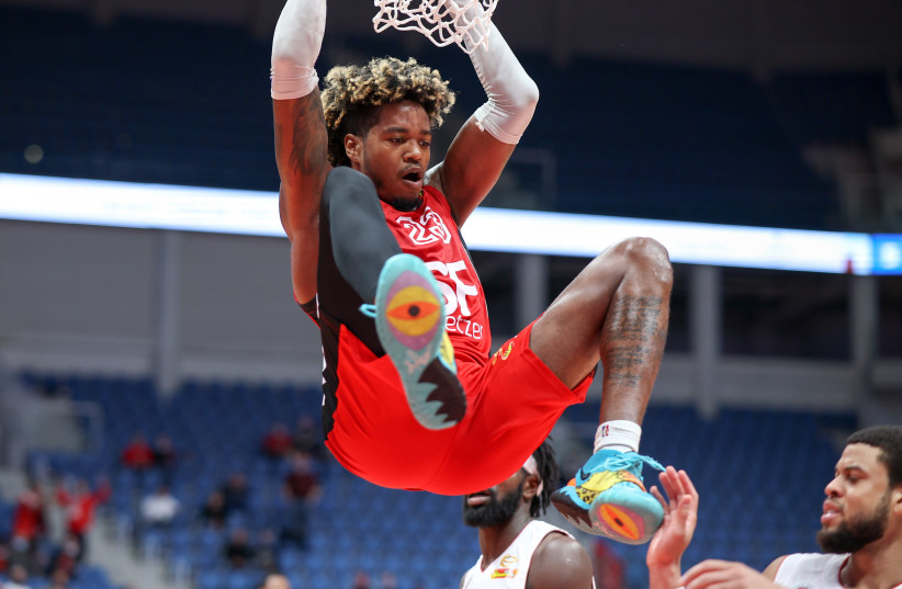 HAPOEL TEL AVIV forward Justin Tillman dunks for two of his 37 points in the Reds' 95-89 road victory over Hapoel Jerusalem in Winner League action in the capital. (photo credit: DANNY MARON)