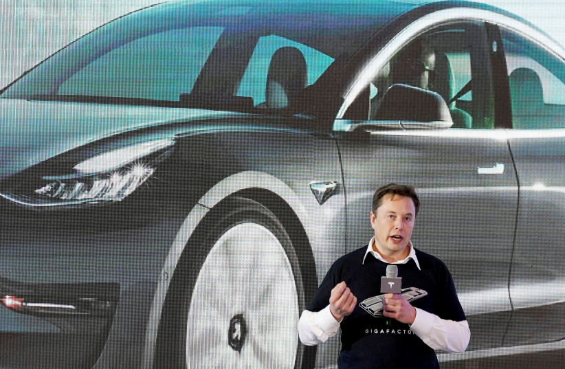 Tesla Inc CEO Elon Musk speaks onstage during a delivery event for Tesla China-made Model 3 cars at its factory in Shanghai, China January 7, 2020. (photo credit: REUTERS/ALY SONG/FILE PHOTO)