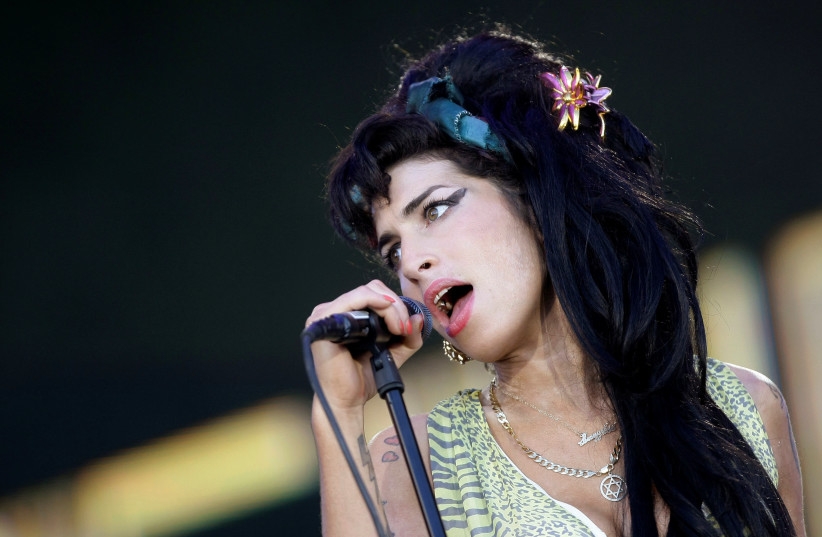 "British singer Amy Winehouse performs during the ""Rock in Rio"" music festival in Arganda del Rey, near Madrid, July 4, 2008 (photo credit: REUTERS/JUAN MEDINA/FILE PHOTO)"