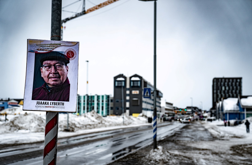 An electoral poster is displayed along a street ahead of the April 6 parliamentary election, in Nuuk, Greenland March 30, 2021. (photo credit: RITZAU SCANPIX/EMIL HELMS VIA REUTERS)