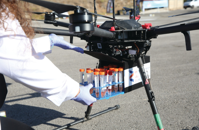 A TECHNICIAN loads lab specimens onto a drone at the Ziv Medical Center in Safed in October. (photo credit: DAVID COHEN/FLASH 90)