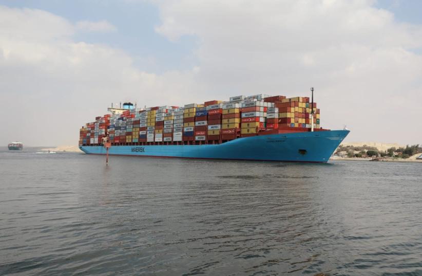 A container ship sails at the Suez Canal, in Ismailia, Egypt March 31, 2021. Suez Canal Authority/Handout via REUTERS (photo credit: REUTERS)