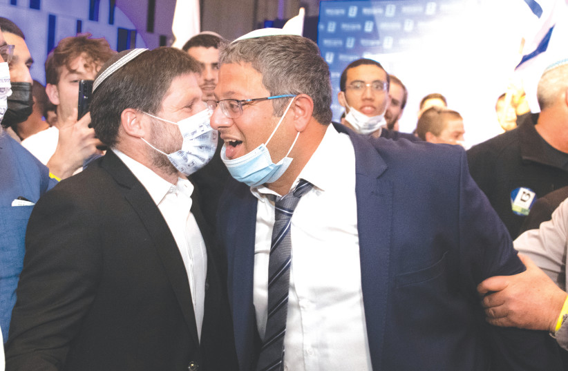 TKUMA PARTY head Bezalel Smotrich and Itamar Ben-Gvir of the Otzma Yehudit Party celebrate at Religious Zionist Party headquarters in Modi'in last Tuesday night. (photo credit: SRAYA DIAMANT/FLASH90)