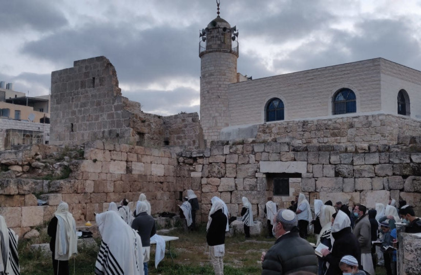 Passover Birkat Kohanim (the priestly blessing) was recited in Mount Hebron at an ancient synagogue from the Byzantine era. (photo credit: Courtesy)