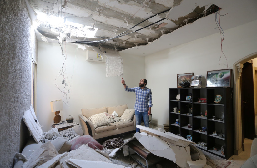 NSPECTING A home damaged by an intercepted missile in the aftermath of what the Saudi-led coalition said was a thwarted Houthi missile attack, in Riyadh on February 28. (photo credit: AHMED YOSRI/ REUTERS)