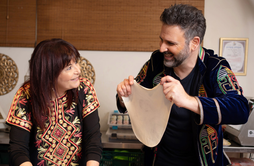 THE WRITER and Yossi Azulay make merry mufletta. (photo credit: RAMI ZINGER)