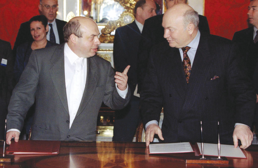EX-SOVIET dissident and then-minister Natan Sharansky (left) meets in Moscow with mayor Yuri Luzhkov, 1997. The book covers Hillel's efforts to build Jewish activism among Sharansky's successors in the former USSR in the 1990s, subsequent to his making aliyah. (photo credit: REUTERS)