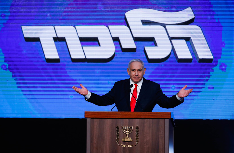 Prime Minister Benjamin Netanyahu addresses his supporters on the night of the Israeli elections, at the party headquarters in Jerusalem, March 24, 2021.  (photo credit: OLIVIER FITOUSSI/FLASH90)
