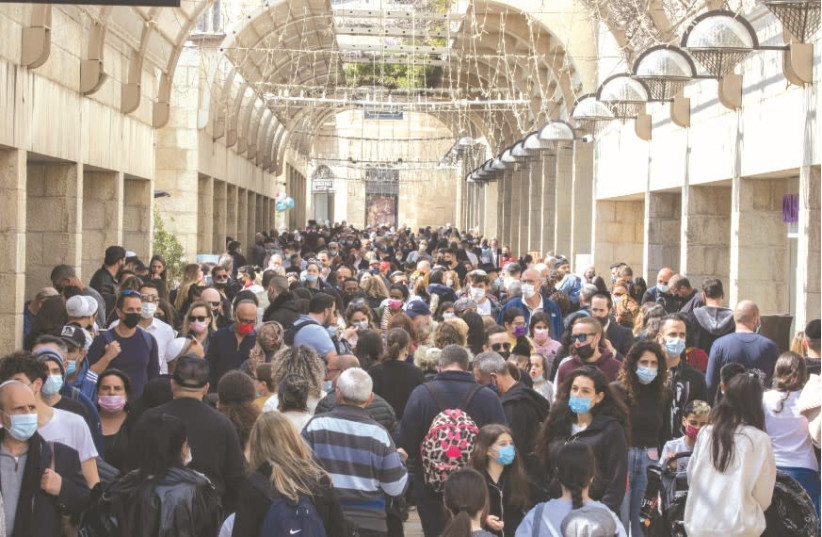 BACK TO NORMAL? Israelis flock to the Mamilla Mall in Jerusalem during Passover this week. (photo credit: OLIVIER FITOUSSI/FLASH90)