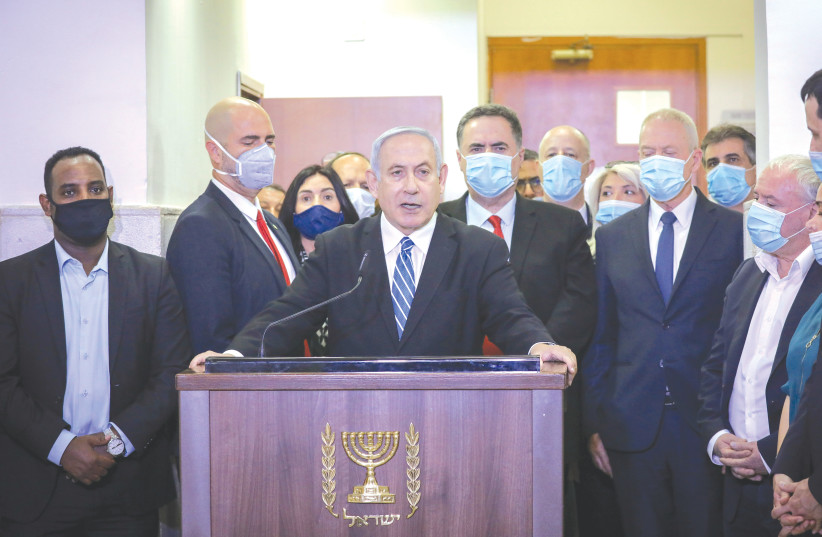 Prime Minister Benjamin Netanyahu delivers a statement before entering the district courtroom where he is facing a trial for alleged corruption crimes, in Jerusalem last May. (photo credit: YONATAN SINDEL/POOL)