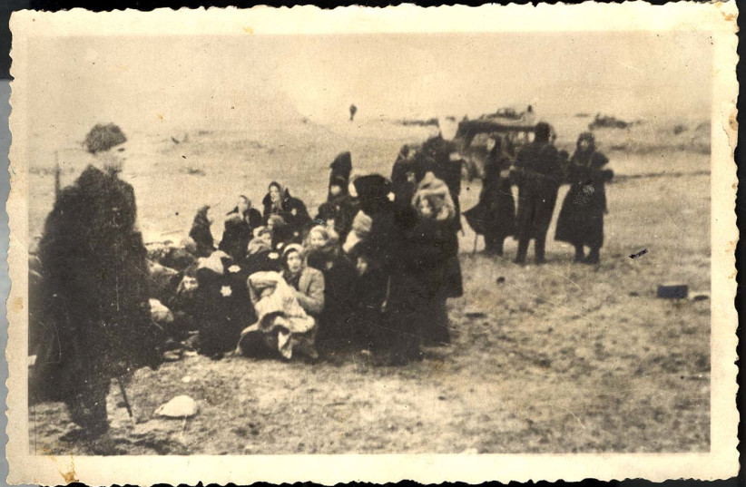 JEWISH WOMEN about to be murdered by Einsatzgruppe A and Latvian collaborators, December 1941 (photo credit: Courtesy)