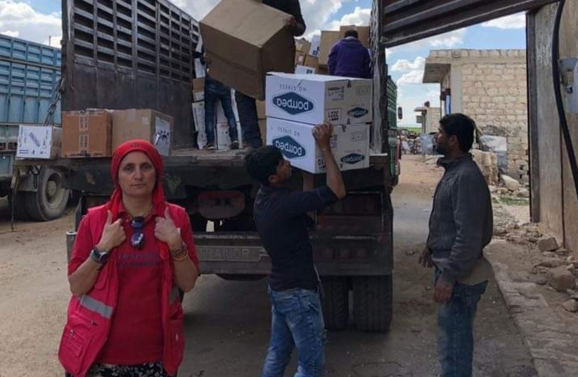 Dr. Nemam Ghafouri delivering humanitarian aid. (photo credit: Courtesy)