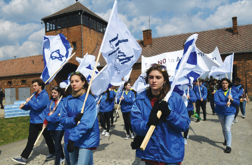 ISRAELIS PARTICIPATE in the March of the Living at the Auschwitz-Birkenau camp site in Poland in May 2019. (photo credit: YOSSI ZELIGER/FLASH90)