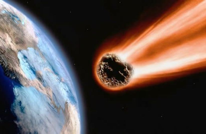 An asteroid is seen heading for Earth in an illustrative photo. (photo credit: PIXABAY)
