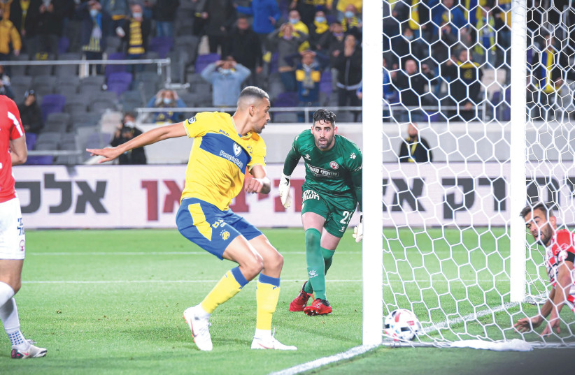 Israel soccer story by Joshua Halickman on page 8 – Picture of Maccabi Tel Aviv vs Hapoel Beersheba  (photo credit: ARIEL SHALOM)