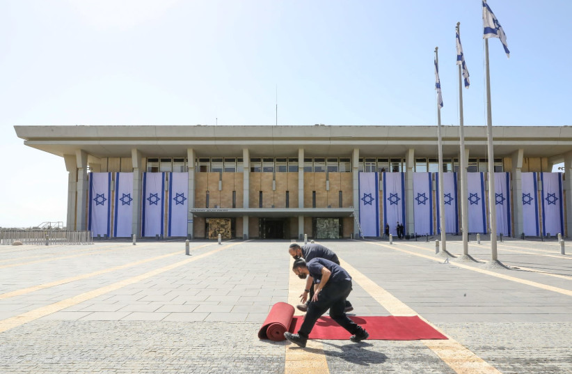 The red carpet is rolled out in front of the Knesset before the new MKs are sworn in. (photo credit: MARC ISRAEL SELLEM/THE JERUSALEM POST)