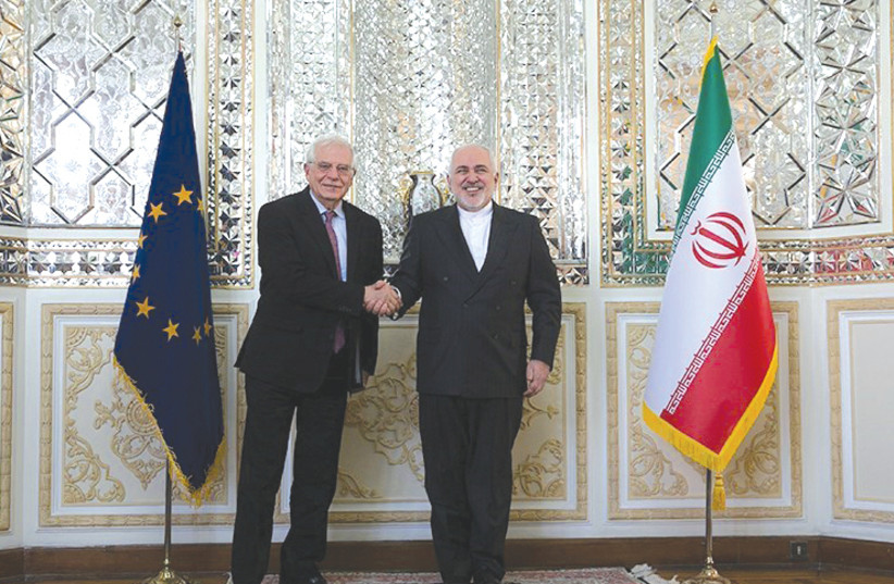 IRANIAN FOREIGN MINISTER Mohammed Javad Zarif (right) shakes hands with Josep Borrell, high representative of the EU for foreign affairs and security policy and vice president of European Commission, in Tehran in February. (photo credit: TASNIM NEWS AGENCY/REUTERS)