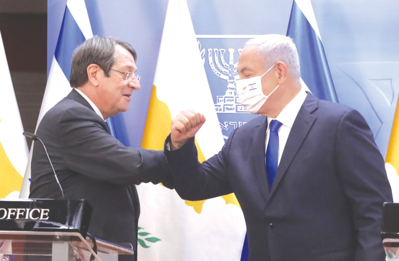 PRIME MINISTER Benjamin Netanyahu and Cypriot President Nicos Anastasiades bump elbows during their meeting in Jerusalem in February. (photo credit: MARC ISRAEL SELLEM/THE JERUSALEM POST)
