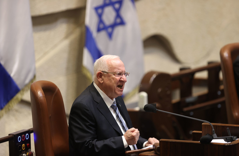 President Reuven Rivlin speaks at the Plenary Hall. during the swearing-in ceremony of the 24th Knesset, at the Israeli parliament in Jerusalem, April 6, 2021. (photo credit: ALEX KOLOMOISKY / POOL)