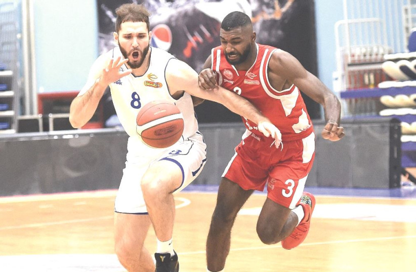 HAPOEL BEERSHEBA and Bnei Herzliya engaged in a fierce Winner League battle on Monday night, with Amir Bell (right) and Beersheba prevailing 77-75.  (photo credit: BERNEY ARDOV)