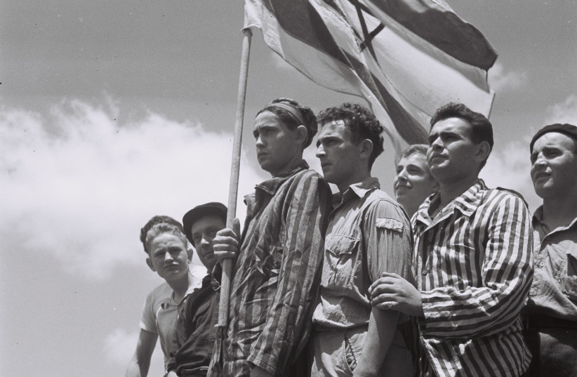 """Buchenwald survivors arrive in Haifa to be arrested by the British, July 15, 1945, from """"To the Promised Land"""" by Uri Dan (Doubleday, 1987) (photo credit: PUBLIC DOMAIN)"""