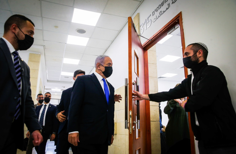 Israeli prime minister Benjamin Netanyahu seen as he arrives for a court hearing at the District Court in Jerusalem on April 05, 2021, PM Netanyahu is on trial on criminal allegations of bribery, fraud and breach of trust. (photo credit: OREN BEN HAKOON/POOL)