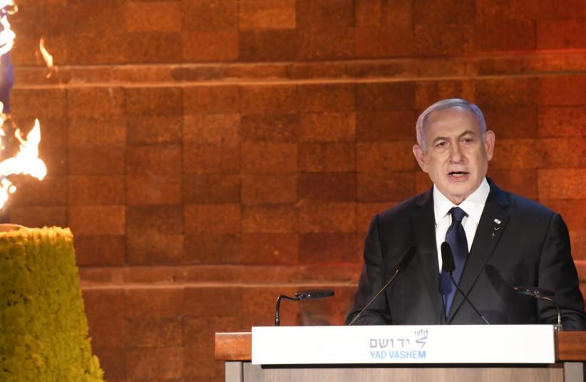 Prime Minister Benjamin Netanyahu speaks at Yad Vashem for Holocaust Remembrance Day, April 7, 2021. (photo credit: AMOS BEN-GERSHOM/GPO)