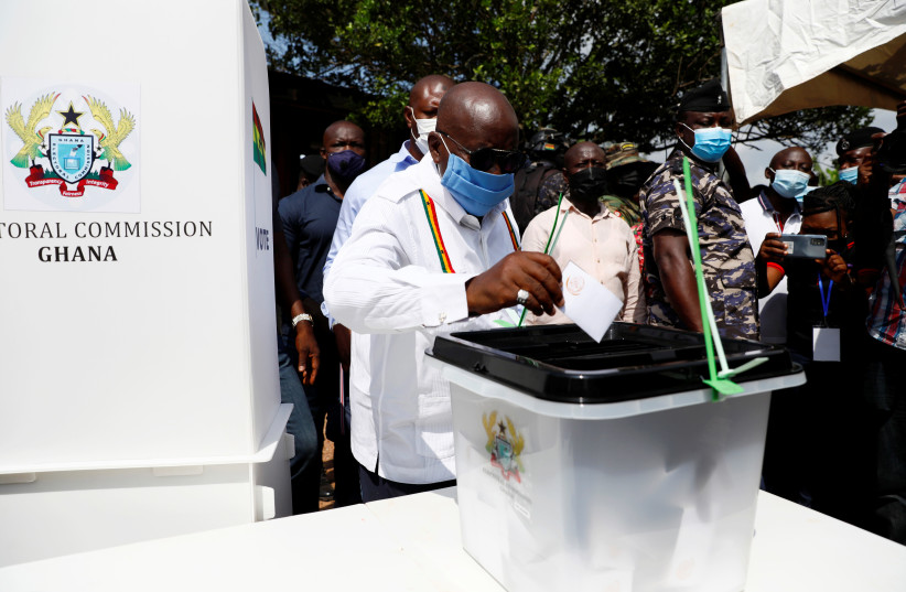 GHANA'S PRESIDENT Nana Akufo-Addo casts his ballot in Kyebi on December 7, 2020. (photo credit: FRANCIS KOKOROKO/REUTERS)