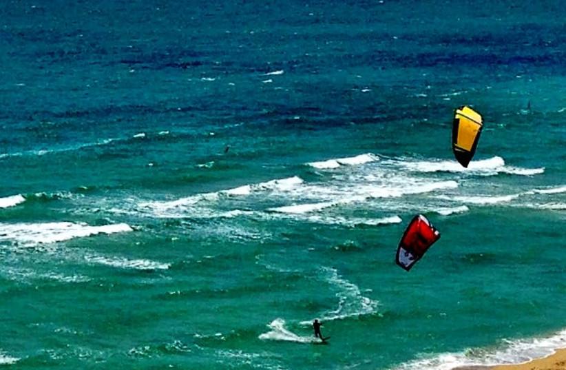 KITE SURFING in Surfside. (photo credit: INES HEGEDUS-GARCIA/FLICKR)