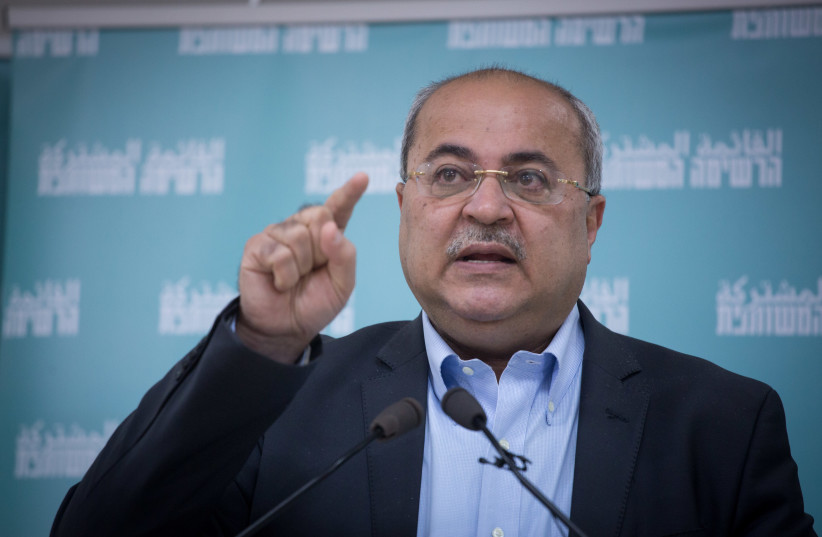 Joint list party member Ahmad Tibi speaks during a press conference presenting the Joint list hebrew election campaign in Tel Aviv, February 23, 2021.  (photo credit: MIRIAM ALSTER/FLASH90)