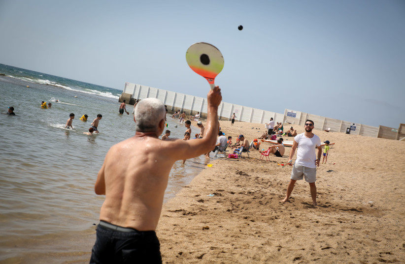 PLAYING MATKOT on Acre beach, which is equipped with a path for disabled swimmers (#42) (photo credit: DAVID COHEN/FLASH 90)