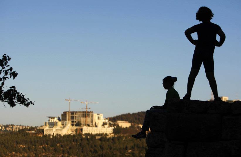 ISRAELI CHILDREN play near the Sataf Springs, featured in the book, just outside Jerusalem. (photo credit: AMIR COHEN/REUTERS)