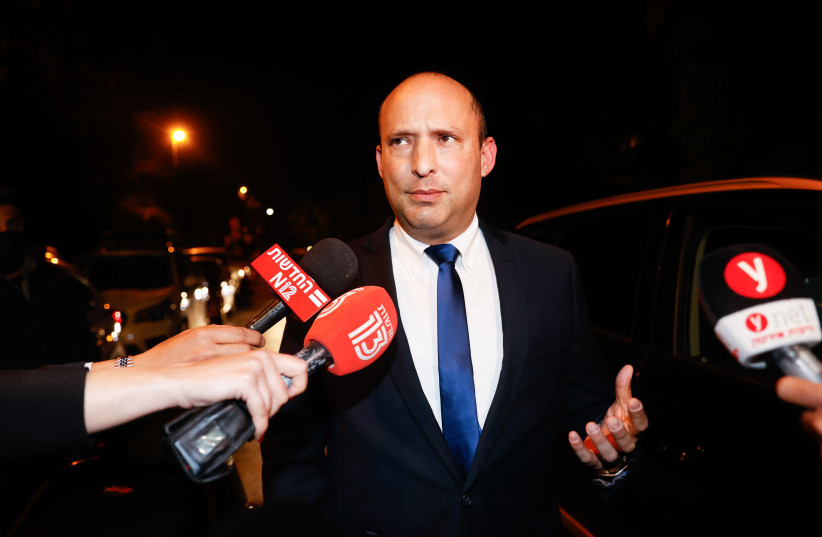 Yamina Party head Naftali Bennett gives a press statement after meeting with Prime Minister Benjamin Netanyahu at his official residence in Jerusalem, April 08, 2021 (photo credit: YONATAN SINDEL/FLASH90)