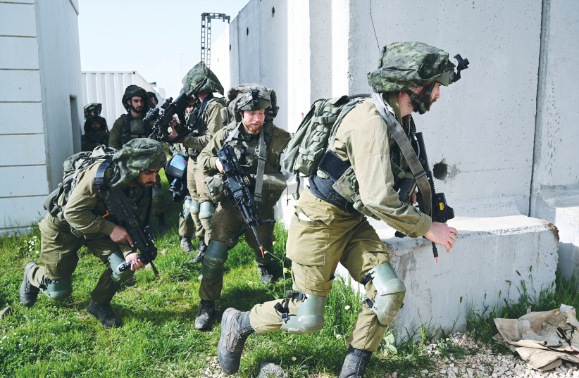 SOLDIERS TRAIN on the Golan Heights on Wednesday. (photo credit: MICHAEL GILADI/FLASH90)
