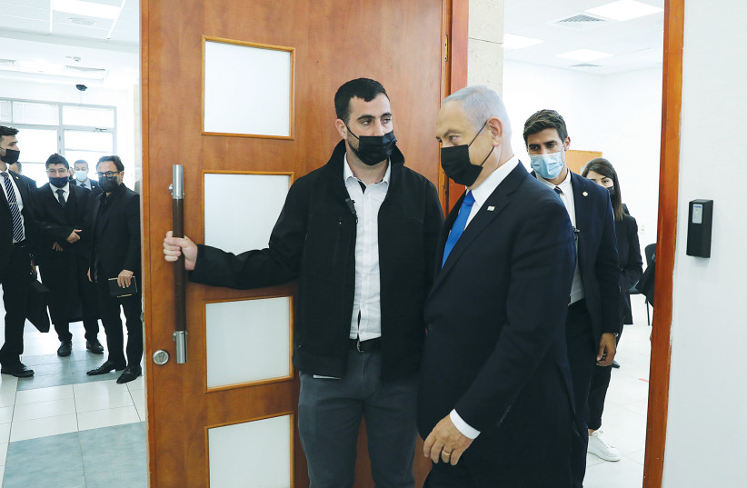 PRIME MINISTER Benjamin Netanyahu leaves the courtroom after a hearing at the Jerusalem District Court this week. (photo credit: ABIR SULTAN/POOL)
