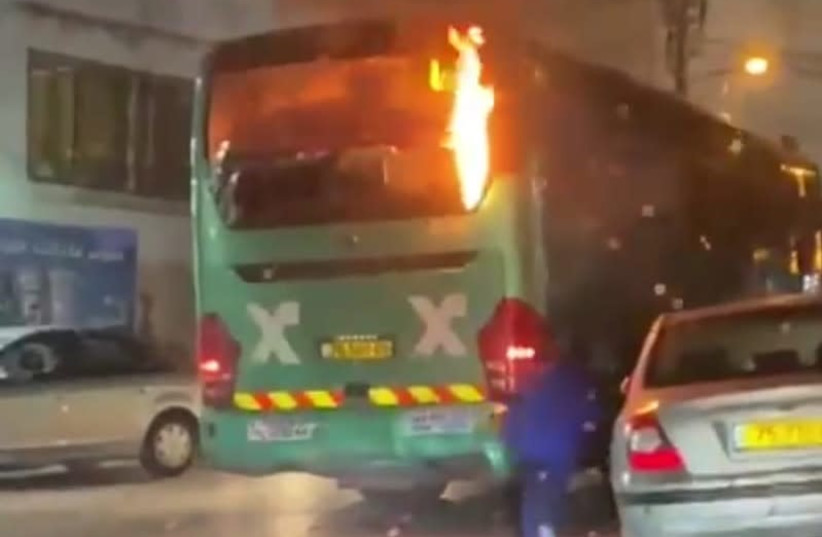 A bus burning from Molotov cocktails in the east-Jerusalem neighborhood of Isawiya, April 9, 2021.  (photo credit: Courtesy)