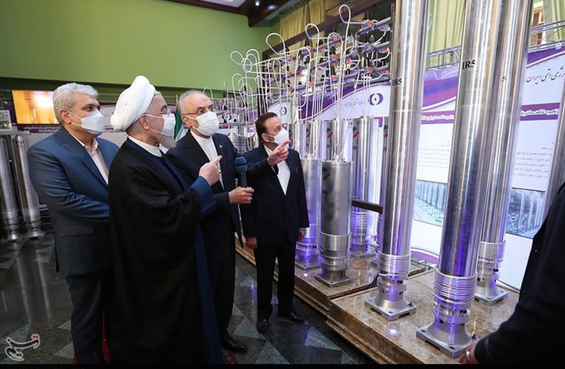 Iranian President Hassan Rouhani unveils and visits exhibition of the Atomic Energy Organization, April 10, 2021 (photo credit: PRESIDENT.IR VIA TASNIM NEWS AGENCY)