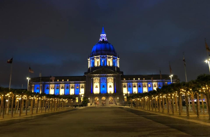 The San Francisco City Hall is seen lit up in blue and white. (photo credit: SHANIE ROTH)