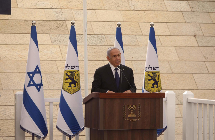Prime Minister Benjamin Netanyahu speaking at a Remembrance Day ceremony on April 13 2021. (photo credit: MARC ISRAEL SELLEM)