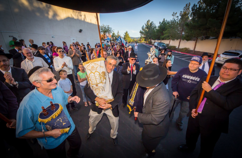Members of the Ahavas Torah Center in Henderson parade through the city during a Torah dedication ceremony in the mid-2010s. The Las Vegas suburb is home to a growing Orthodox Jewish population. (photo credit: COURTESY OF AHAVAS TORAH CENTER)
