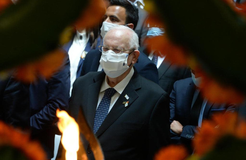 President Reuven Rivlin (R) attends the Remembrance Day ceremony at Har Herzl's memorial hall, April 14 2021.  (photo credit: Mark Neiman/GPO)