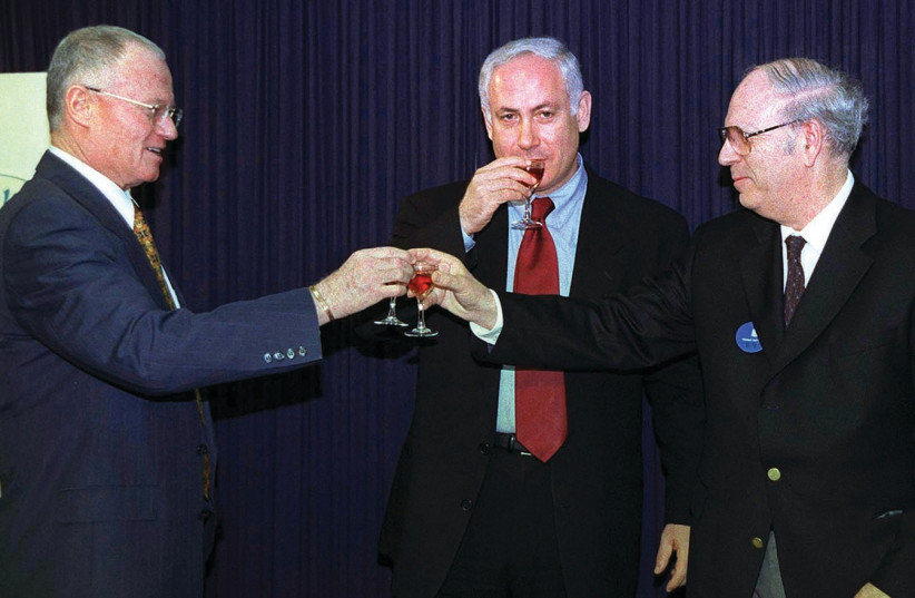 PRIME MINISTER Benjamin Netanyahu joins Halevy as he succeeds outgoing Mossad chief Danny Yatom in a toast at the Prime Minister's Office during the Mossad handover ceremony April 8, 1998 (photo credit: REUTERS)