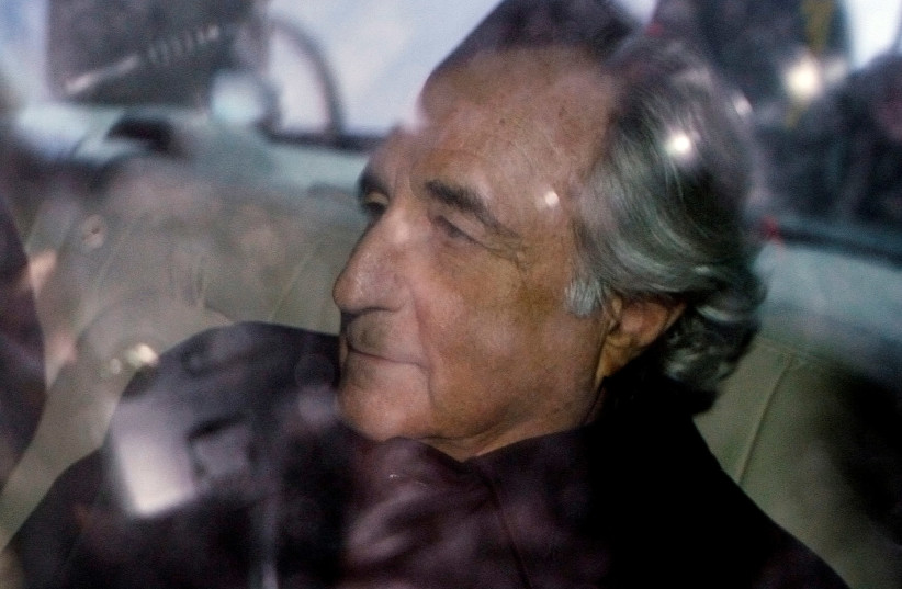 Bernard Madoff is escorted in a vehicle from Federal Court in New York January 5, 2009. (photo credit: LUCAS JACKSON/REUTERS)