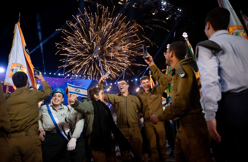 Israeli soldiers dance during the 73rd anniversary Independence Day ceremony, held at Mount Herzl, Jerusalem on April 14, 2021. (photo credit: YONATAN SINDEL/FLASH 90)